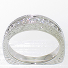 Platinum hand-engraved high-profile channel-band with 0.45 carats total weight of round melee diamonds