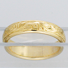 14 Karat Yellow Gold half-round band with western hand-engraved pattern