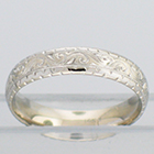 14 Karat White Gold hand-engraved comfort-fit band with western pattern and zig-zag borders