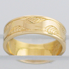 14 Karat Yellow Gold flat band with lazy-river hand-engraved pattern