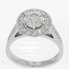"Platinum ""halo"" ring with round brilliant diamond in 6-prong setting above bead-set round plate with bead-set diamonds on cathedral-style shank"