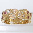 14 Karat Yellow Gold Leafy band with bead-set purple and white diamonds