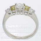 Platinum 5-stone ring with white and canary-yellow round brilliant diamonds in 4-prong gallery settings