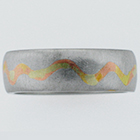 Brushed Platinum canyon band with multi-colored gold inlay.