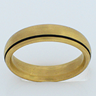 14 karat yellow gold brushed comfort-fit band with offset blackened lathe line.