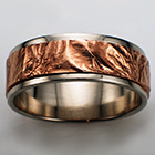 14 karat white gold flat band with reticulated 14 karat rose gold sheet overlay.