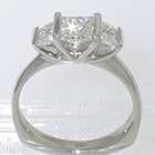 plat.ring w/ 1ct princess diampnd and 2 trapezoid cut side diamonds
