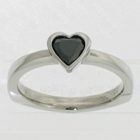 Palladium solitaire with black heart-shaped diamond in full bezel setting
