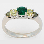 platinum ring with round emerald, two hexagonal-shaped yellow diamonds, and two round green diamonds - all natural, all set in prong-style settings.