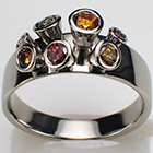 "Platinum ""coney"" ring with natural fancy colored diamonds in tapered bezels"