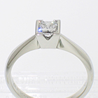 Platinum solitaire with princess-cut diamond in v-cut semi-bezel setting