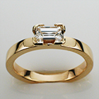 14 karat yellow gold flat band with 0.90 carat emerald-cut diamond in semi-semi-bezel(modified to 4-corners).