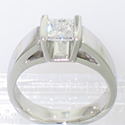 platinum square-saddle ring with channel-set princess-cut diamond in view-through shank