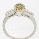 Platinum ring with 1.14 carat natural cinnamon-green fancy colored diamond with 0.46 carat total weight (0.23 ct. each)tapered baguettes. (alternate view)
