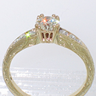 14 Karat yellow gold hand-engraved tapered channel ring with 0.67 carat round brilliant diamond in empire-style head