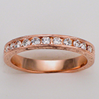 14 karat rose gold hand-engraved band with 0.50 carat of round channel-set diamonds.