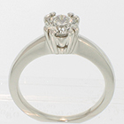 14 Karat White Gold solitaire with 0.80 carat round brilliant diamond in 8-prong fishtail-style fancy head