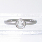 Platinum stacker ring with 0.40 carat rose-cut diamond in full polished bezel with cut-outs to allow band to slide under setting. brushed finish on band (alternate view)