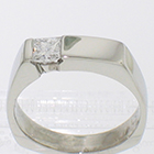 platinum asymmetrical solitaire with flush-set 0.32 carat princess-cut diamond