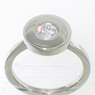 Platinum solitire with 0.55 carat round brilliant diamond in disc bezel on flat band