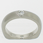 Palladium solitaire with 0.15 carat round brilliant diamond flush-set in brushed heavy shank