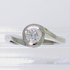 Platinum wrap-around diamond solitaire