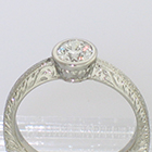 Platinum hand-engraved solitaire with 0.54 carat round brilliant diamond in full bezel (detail view)