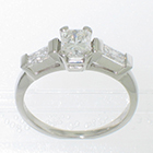 Platinum 3-stone ring with 0.81 carat radiant-cut diamond set in 4-prong gallery head and 0.42 carat total weight brilliant-cut baguettes channel-set between gallery bars