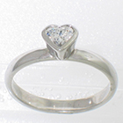 Platinum solitaire with heart-shaped diamond in full bezel