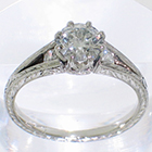 Platinum hand-engraved split-shank ring with 0.72 carat round brilliant diamond in 8-prong fancy crown-style head and 0.08 carat of round melee diamonds in shank