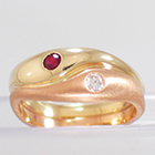 14 Karat 2-tone Yellow and Rose Gold ying-yang ring with flush-set round Ruby and Diamond