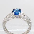 Platinum Hand-engraved 4-prong Sapphire ring with channel-set diamonds