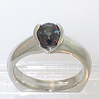 Palladium Oval-shaped Color-changing African Sapphire solitaire ring in semi-bezel setting