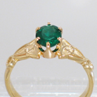 14 Karat Yellow Gold Celtic Solitaire ring with Oval-shaped emerald in 6-prong crown-style setting