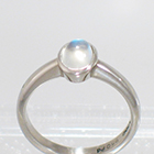 Palladium solitaire ring with oval-shaped caboschon-cut moonstone in full-bezel setting