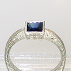 Palladium hand-engraved solitaire ring with princess-cut Sapphire in full bezel setting