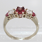 14 Karat White Gold 5-stone ring with oval-shaped Pink Sapphire, round white diamonds, and round pink Sapphires in gallery-style prong settings