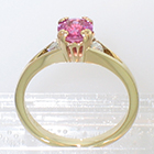 "14 Karat Yellow Gold 3-stone ring with round Pink Sapphire in fancy ""empire-style"" 8-prong setting and round white diamonds channel-set into split shank"