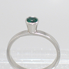 "Platinum ""stacker"" solitaire with round Emerald in high-profile full bezel setting on flat band"