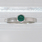 "Platinum ""stacker"" solitaire with round Emerald in high-profile full bezel setting on flat band (alternate view)"