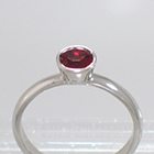 Platinum Solitaire with round Ruby in full bezel setting