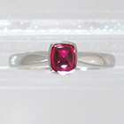 Platinum Solitaire ring with cushion-shaped bullet-caboschon-cut Ruby in full bezel setting (alternate view)