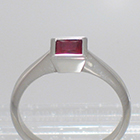 Platinum Solitaire with princess-cut Ruby in full bezel setting