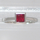 Platinum Solitaire ring with princess-cut Ruby in full bezel setting (alternate view)