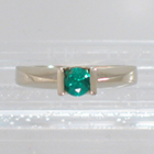 14 Karat White Gold Solitaire ring with round Emerald in Square saddle setting