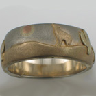 14 karat multi-colored gold band with southwestern theme and sand-blasted finish.