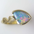 yellow gold free-form opal ring with squiggle