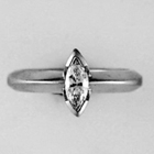 platinum knife-edge style band with marquis-cut diamond solitaire
