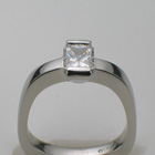 platinum ring with radiant-cut diamond.