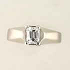 platinum ring with emerald-cut diamond in 4-prong setting on angular shank